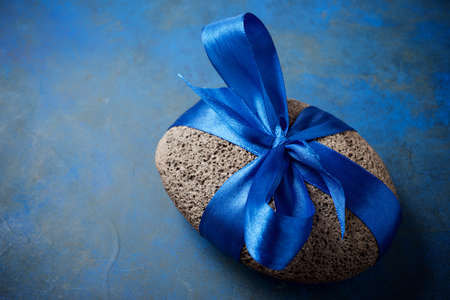 Stone with a blue bow.