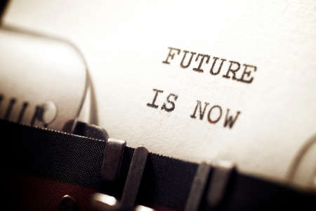 Future is now phrase written with a typewriter.