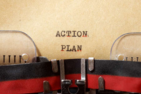 Action plan phrase written with a typewriter.