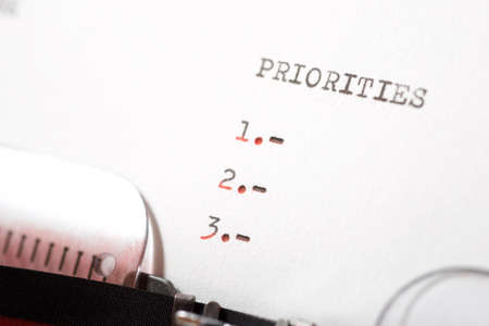 Priorities word written with a typewriter. Stock Photo