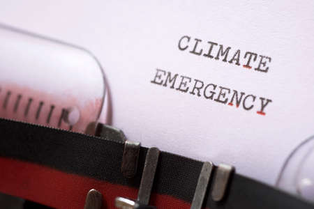 Climate emergency phrase written with a typewriter.