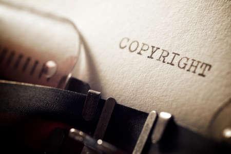 Copyright word written with a typewriter. 版權商用圖片