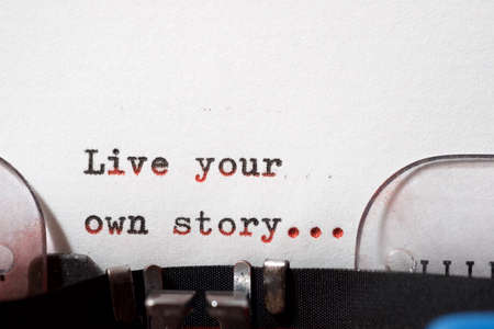 Live your own story phrase written with a typewriter.