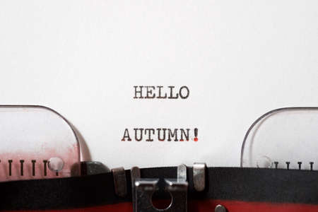 Hello autumn phrase written with a typewriter.