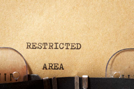 Restricted area phrase written with a typewriter.