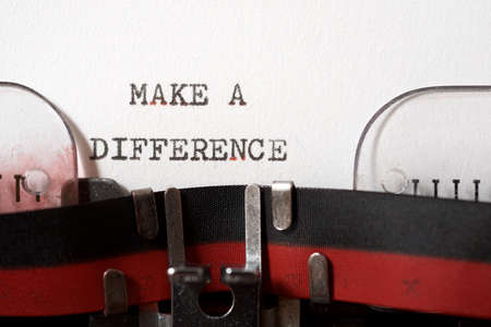 Make a difference phrase written with a typewriter.