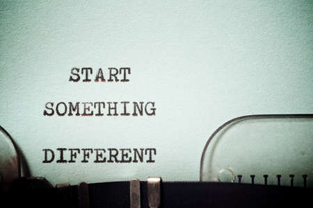 Start something different phrase written with a typewriter.