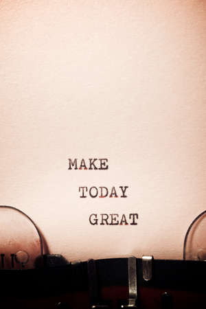 Make today great phrase written with a typewriter.