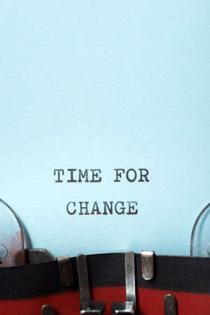 Time for change phrase written with a typewriter.