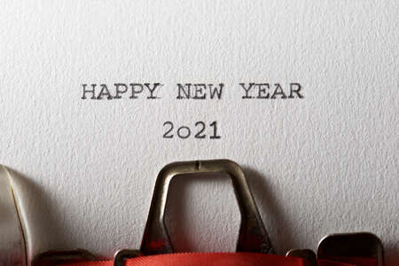 The sentence, Happy New Year 2021, written with a typewriter.