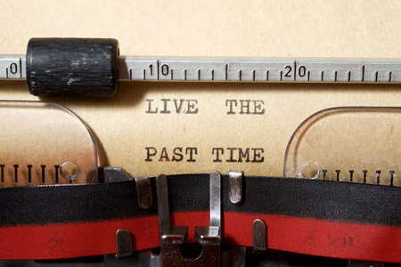 Live the past time phrase written with a typewriter.