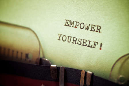 Empower yourself phrase written with a typewriter.