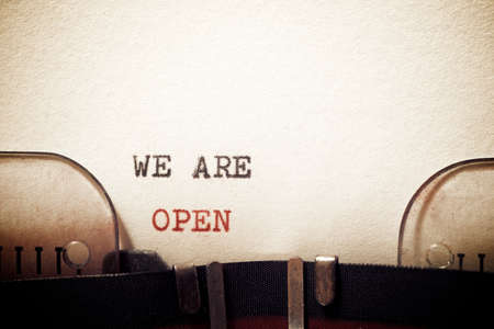 We are open phrase written with a typewriter.