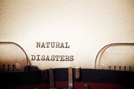 Natural disasters phrase written with a typewriter.