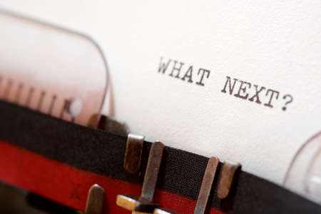 What next? phrase written with a typewriter.