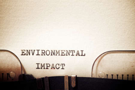 Environmental impact phrase written with a typewriter.