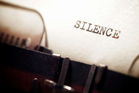 Silence word written with a typewriter.