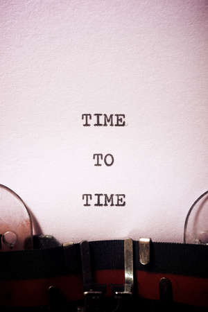 Time to time phrase written with a typewriter. Stock fotó