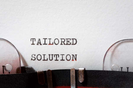 Tailored solution phrase written with a typewriter. 写真素材