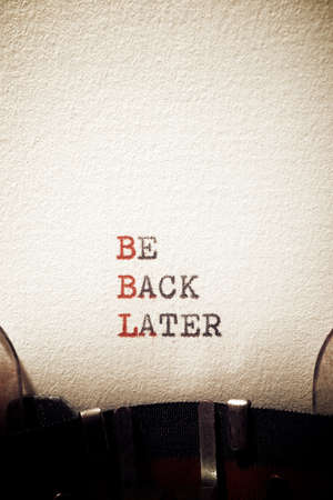 Be back later phrase written with a typewriter.