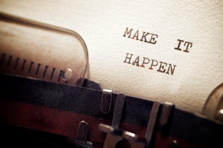 Make it happen phrase written with a typewriter.