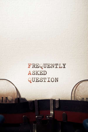 Frequently asked question phrase written with a typewriter.