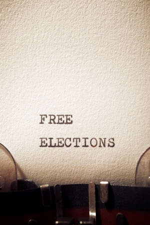 Free elections phrase written with a typewriter.