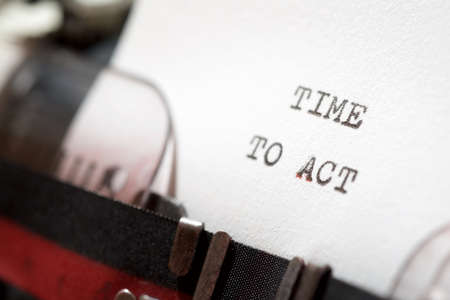 Time to act phrase written with a typewriter.