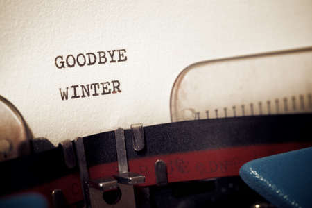 Goodbye winter phrase written with a typewriter.