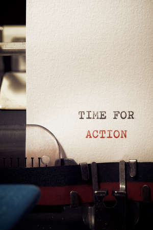 Time for action phrase written with a typewriter.