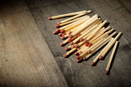 Matches on a wood table.