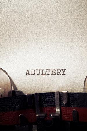 Adultery word written with a typewriter. Standard-Bild