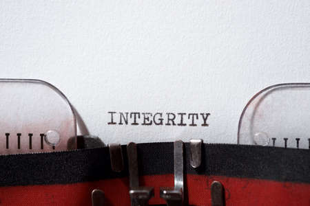 Integrity word written with a typewriter. Stock Photo