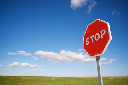 Stop traffic sign with cloudy sky. Stock Photo