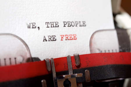 We, the people are free phrase written with a typewriter.