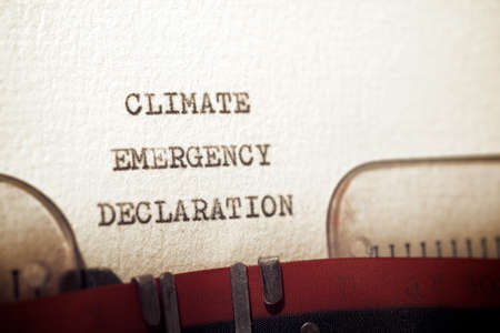 Climate emergency declaration phrase written with a typewriter.