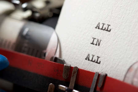 All in all phrase written with a typewriter.