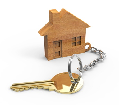 Golden key with wooden houses Stock Photo - 19937033