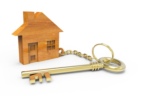 secure home: Golden key with wooden houses