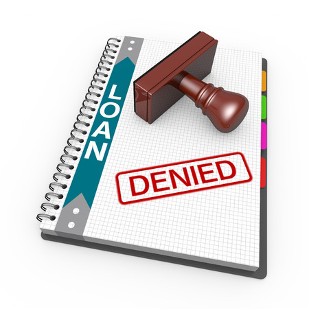 refused: Notebook and rubber stamp with the word denied Stock Photo