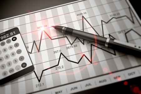 Pen and calculator on stock chart Standard-Bild