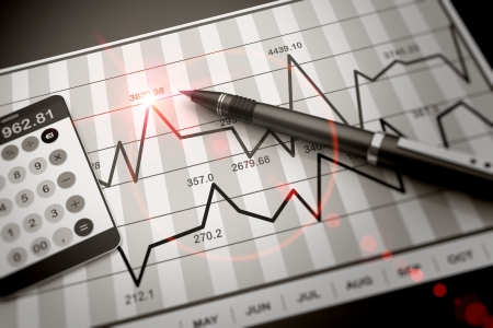 Pen and calculator on stock chart Banque d'images