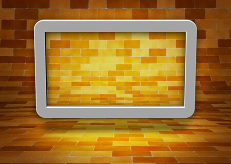 bric: Computer tablet in a brick wall background