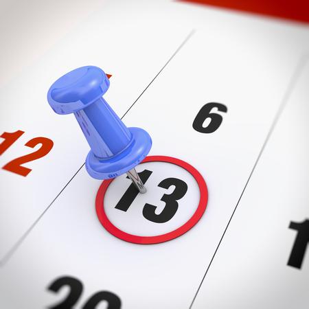 Calendar and blue pushpin. Mark on the calendar at 13. photo