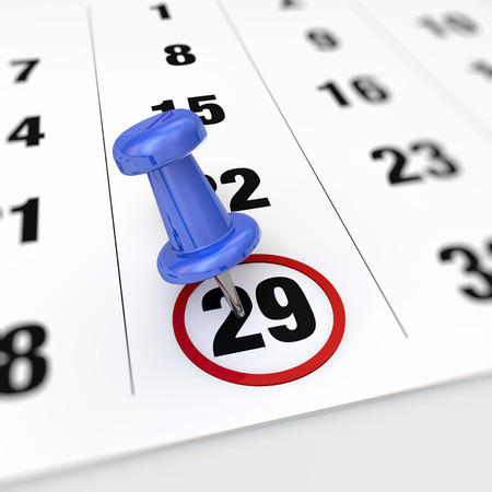 20 29: Calendar and blue pushpin. Mark on the calendar at 29. Stock Photo