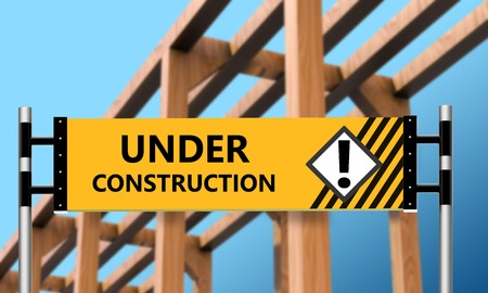 caution sign: The wooden house with a warning label under construction