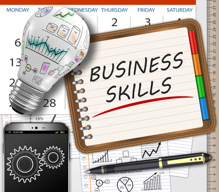 skills: Business skills handwritten in a notebook on the table as concept