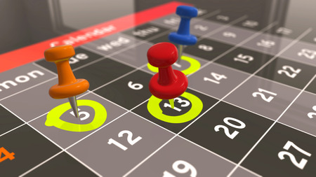 Marking day in calendar. Different days of the month are marked with a pushpin. Stock Photo