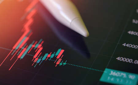 Analysis of business chart and online financial market data with digital pen close up background Stockfoto