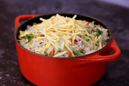 Brazilian Rice Food in BBQ. With potato and bacon. Beautiful pots and background. Top view.